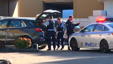Police arrested the driver of the grey Holden Equinox car at a petrol station in Sydney's west on Monday morning.