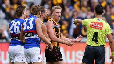 Out of line: Hawk James Sicily gives away a free kick in the fourth quarter, which the Bulldogs converted into a goal to take the lead.