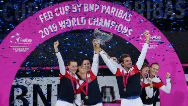 Glittering prize: Team France celebrate their first Fed Cup win since 2003.