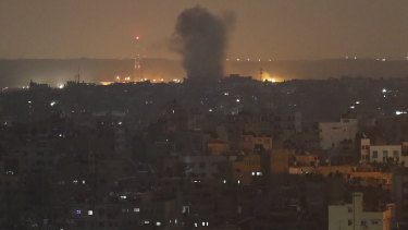An explosion caused by Israeli air strikes in Gaza City early on Thursday.