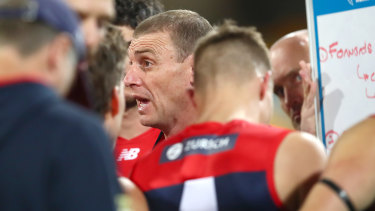 Melbourne coach Simon Goodwin addresses his players during the match against Port Adelaide.