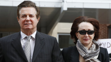 Paul Manafort, left, President Donald Trump's former campaign chairman, walks with this wife Kathleen Manafort, as they arrive at the Alexandria Federal Courthouse in March.
