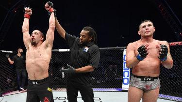 Australian UFC star Robert Whittaker celebrates after his win over Darren Till.