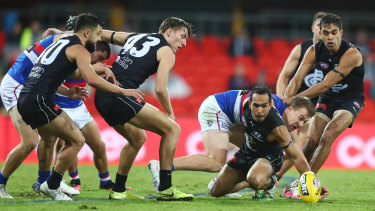 In the thick of it: Carlton forward Eddie Betts scrambles to clear the ball from the pack during their round 6 clash against the Western Bulldogs at Metricon Stadium on the Gold Coast.
