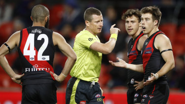 Lost in translation: Essendon's Zach Merrett (right) appeals to the umpire after the controversial call made during their round 9 match against the Lions.
