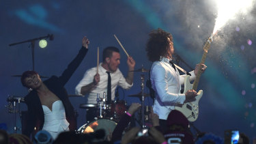 Peking Duk perform ahead of the opening State of Origin game at the MCG.