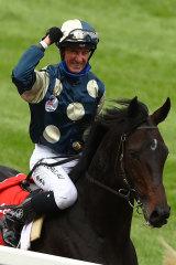 A jubilant Glen Boss celebrates after winning the Cox Plate on Sir Dragonet.