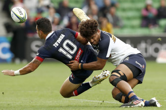 Rob Valetini of the Brumbies tackles Matt To'omua of the Rebels during the round nine Super RugbyAU match between the ACT Brumbies and the Melbourne Rebels.