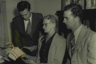 Reading some of the telegrams sent to Mr Chifley's home from all over the world are Mr Chifley's nephews,  Mr Joe Chifley and Mr John Chifley and Mrs Isabel Clark, June 21, 1951.