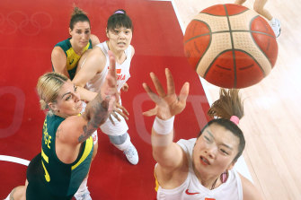 China's Meng drives to the basket against Cayla George.