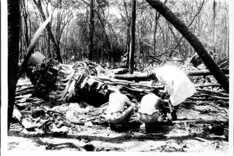 The wreckage of the downed plane, pictured several weeks after it crashed in 1961.