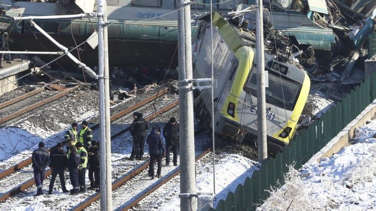 Rescue crews work at the scene of a train accident in Ankara, Turkey.