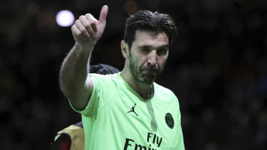 Thumbs up: Veteran PSG keeper Gianluigi Buffon salutes the faithful at Old Trafford.
