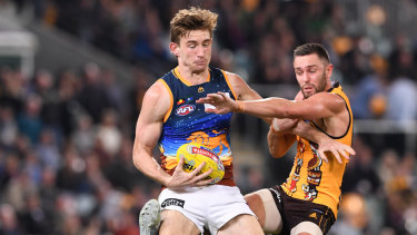 Old-school: Harris Andrews (left) up against a former favourite, Jack Gunston.
