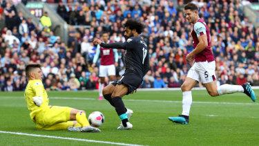 Blocked: Mohamed Salah zeroes in on goal at Turf Moor.