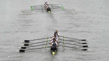 Cambridge, top, lead Oxford down the Thames during the women's boat race on Sunday.