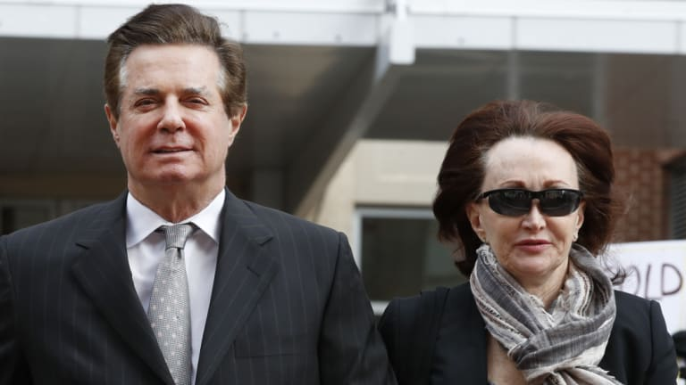 Paul Manafort and his wife Kathleen Manafort arrive at the Alexandria Federal Courthouse in March.