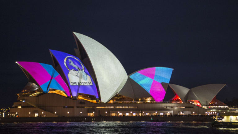 Protestors shine light onto the sails of the Opera House during the launch of the Everest barrier draw projection.