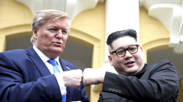 U.S. President Donald Trump impersonator Russell White, left, and Kim Jong-un impersonator Howard X pose for photos outside the Opera House in Hanoi, Vietnam.