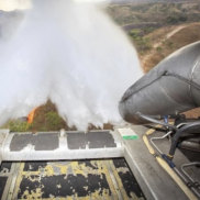 In this photo released by Brazil Ministry of Defense, a C-130 Hercules aircraft dumps water to fight fires raging in Brazil's Amazon, on Saturday.
