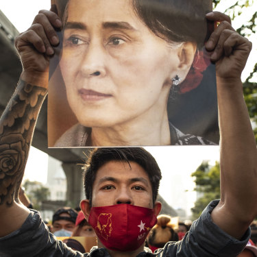 A demonstrator holds up a poster of Aung San Suu Kyi outside the Embassy of Myanmar in Bangkok, Thailand, on February 1.