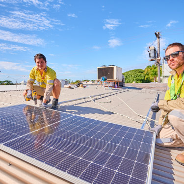 Gas plant electricians Ciaran Fallon and Tom Willis at their side project installing rooftop solar.