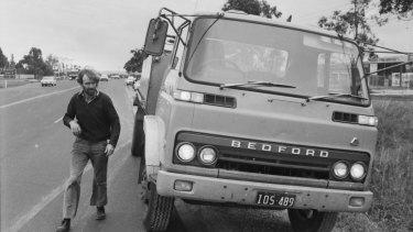 Bill Johnston of Skipton who crashed through the Melton blockades examines his truck for any damage.