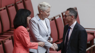 Julia Banks and Kerryn Phelps shake hands with Richard Di Natale after the bill passed the Senate on Wednesday.