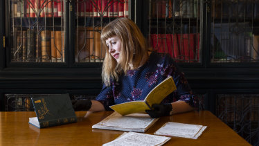 State Library of NSW curator Sarah Morley with the original manuscript of Ethel Turner's Seven Little Australians. It has been included in the Unesco Australian register of the memory of the world.