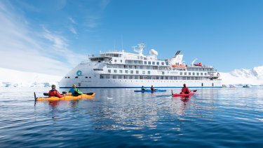 The Greg Mortimer cruise ship in Antarctic waters.