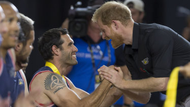 Britain's Duke of Sussex, Harry, presents a medal during the presentation following the Wheelchair Basketball Final.