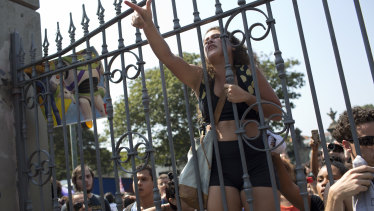 Students and National Museum employees protested outside the institution.