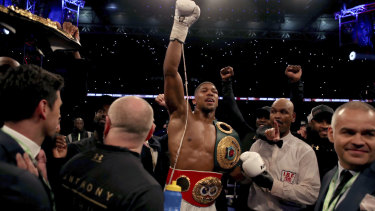 Joshua celebrates winning against Ukrainian boxer Wladimir Klitschko at Wembley Stadium in 2017.