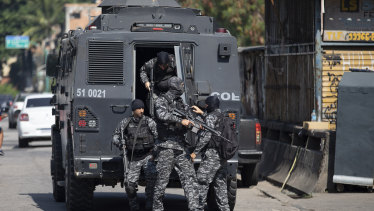 Police get out of an armored vehicle during an operation against alleged drug traffickers in the Jacarezinho favela of Rio de Janeiro, Brazil.
