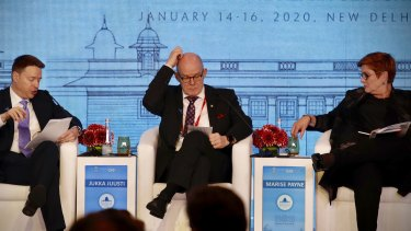 Australian Foreign Minister Marise Payne, right, US Deputy National Security Adviser Matthew Pottinger, left, and Permanent Secretary minister of Defense, Finland, Jukka Justin, centre at the Raisina Dialogue global conference in New Delhi, India.