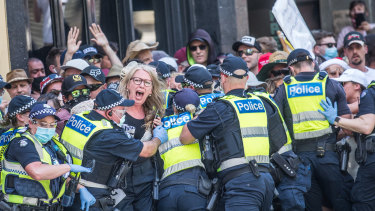 Police encircle protesters as tensions flare at a lockdown protest on November 3.