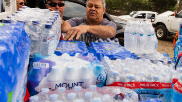 Huge amounts of bottled water have been delivered to towns hit by bushfires, as Coca-Cola Amatil's share price hits five-year highs.