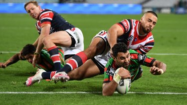 Alex Johnston crosses for one of his five tries against the Roosters.