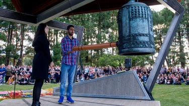 Yasmin and Ali Bulbul ring the Nara peace bell 50 times on Tuesday night for the 50 victims of the Christchurch terrorist attack.