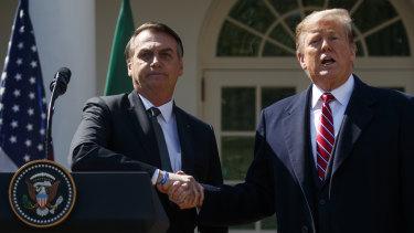 President Donald Trump and Brazilian President Jair Bolsonaro shake hands during their press conference.