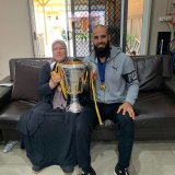 Bachar Houli with his mother, Yamama, and the 2019 premiership cup.