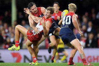 Michael Hibberd, left, tackles Sydney's Jordan Dawson last year,