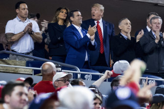 US President Donald Trump, centre, accompanied by first lady Melania Trump and Republican lawmakers, reacts as the stadium boos when he is shown on the giant screen during a baseball World Series game between the Houston Astros and the Washington Nationals at Nationals Park in Washington on Sunday.