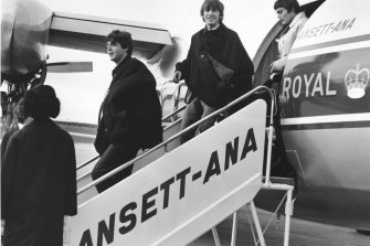 Beatles Paul McCartney, George Harrison and Jimmy Nicol arriving at Essendon Airport in June 1964