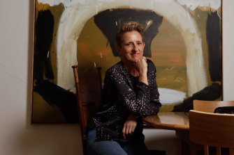 """Charlotte Wood (in front of painting by Carly Earl): """"I'm one of the nappers, usually when my conscious mind is trying to flee a problem on the page."""""""