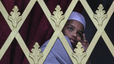 A Sri Lankan Muslim boy looks out from the window of a Mosque before Friday prayers in Colombo.