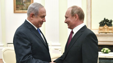 Russian President Vladimir Putin, right, shakes hands with Israeli Prime Minister Benjamin Netanyahu during their meeting at the Kremlin in Moscow on July 11.