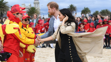 Harry and Meghan meet the lifesavers on South Melbourne beach.