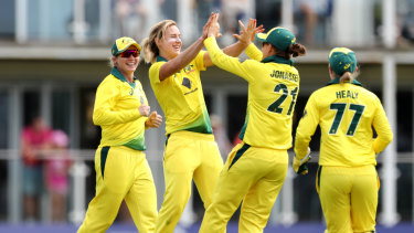 Australia's Ellyse Perry (middle) celebrates taking one of her seven wickets during the Third One Day International of the Women's Ashes.