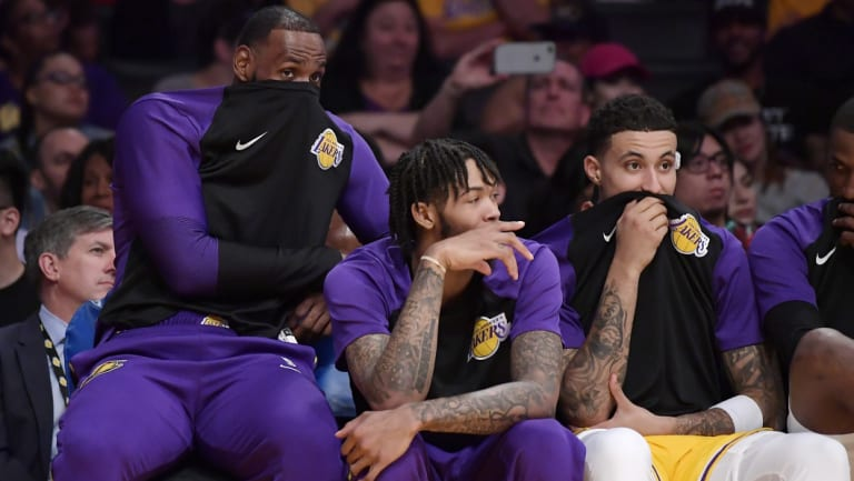 LeBron James (left) on the Lakers' bench with Brandon Ingram (centre) and Kyle Kuzma.